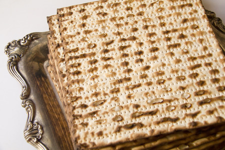 seider: Symbols of Passover- Jewish Matza on Decorated Silver Plate.CloseUp