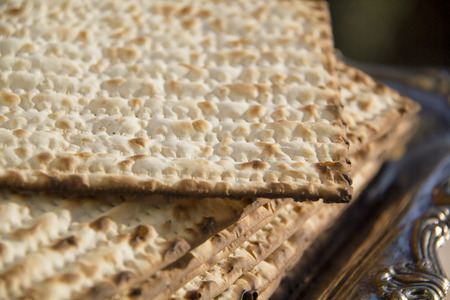 seyder: Jewish Matzoh on Decorated Silver Plate.CloseUp Stock Photo