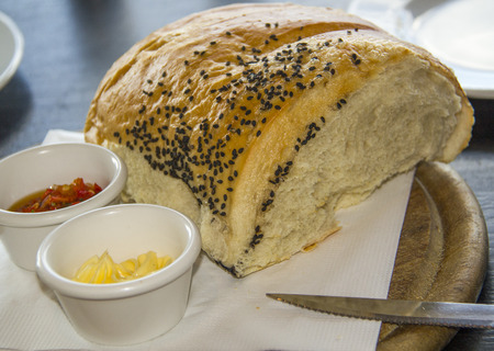 Spicy spread in ramekin with bread loaf, appetizer, breakfast or snack photo
