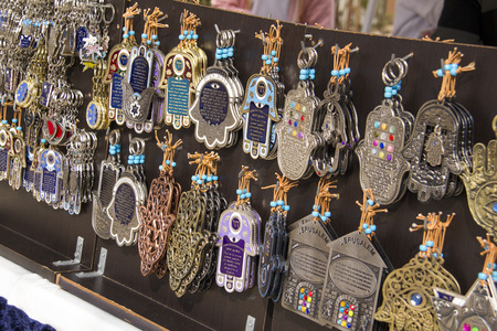 Tourist shop market stall with Israely souvenirs.\Hamsa\ - palm with jewish blessing.Israel