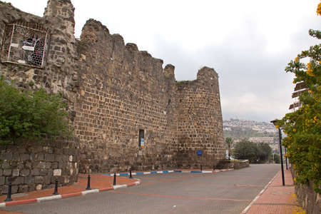 crusaders: View to Tiberias Fort Ruins,Israel ,Tiberias - town on the Sea of Galilee.Typical  black basalt using for Crusaders Fort Building,