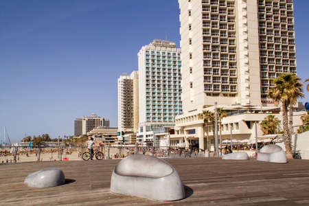 Tel Aviv,Israel - APRIL 7, 2015: Modern  Hotels on the on Mediterranean Seashore in Tel-Aviv in sunny day.New Promenade is popular  place for tourists and locals.Israel Editorial