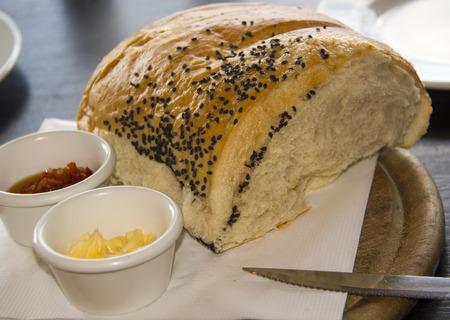 ramekin: Spicy spread in ramekin with bread loaf, appetizer, breakfast or snack