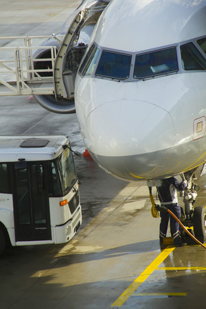 military invasion: Passenger aircraft maintenance before flight at airport. Stock Photo