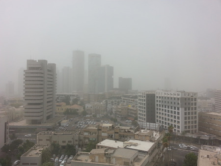 Tel Aviv, Israel - September 8, 2015:Limited visibility is seen during an unusual weather in Israel combine extreme heat ,dust and yellow skies with the country being covered by a massive Middle Eastern sand storm in Tel Aviv,Israel