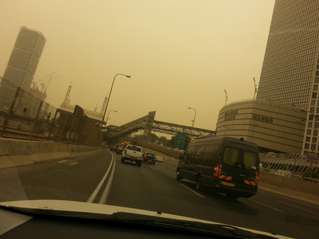 extreme heat: Tel Aviv, Israel - September 8, 2015:  Hamsin days in Israel combine extreme heat ,dust and yellow skies with the country being covered by a massive Middle Eastern sand storm in Tel Aviv,Israel