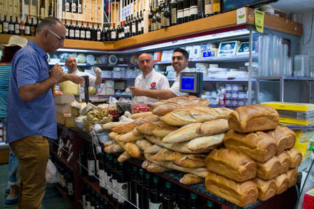 jewish group: Jerusalem,Israel - JULY 30, 2013: Unidentified sellers and shoppers in the Grocery in Jerusalem Market in Jerusalem,Israel  on JULY 30, 2013. The Jerusalem Market  Mahane Yehuda is popular place for food shopping for locals and tourists