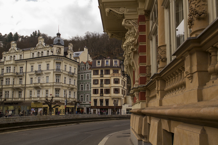 abreast: Karlovy Vary,Czech Republic - March 21: Tourists on the Tepla river Promenade on  March 21, 2014 in Karlovy Vary. Karlovy Vary historically famous for its hot springs 13 main springs, about 300 smaller