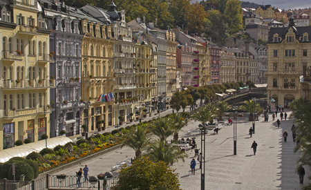 karlovy vary: Karlovy Vary,Czech Republic - September 30: Tourists on the Tepla river Promenade on  September 30, 2015 in Karlovy Vary. Karlovy Vary historically famous for its hot springs 13 main springs, about 300 smaller Editorial
