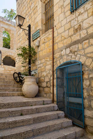 jewish town: Typical street alley in Safeds old city with stone walls and blue coloured doors.Since the 16th century, Safed has been considered one of Judaisms Four Holy Cities, along with Jerusalem, Hebron and Tiberias;4 since that time, the city has remained a cen