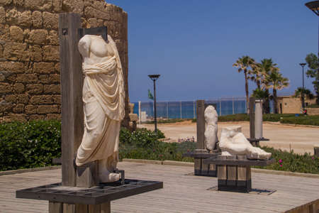 onwards: Ancient statues and marine artifacts in harbor of Caesarea National Park.Israel.Caesarea Maritima from 133 AD onwards, was a city and harbor built by Herod the Great about 25-13 BC. Today, its ruins lie on the Mediterranean coast of Israel