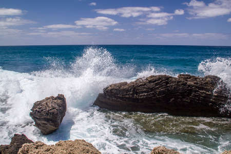 Waves crashing down at the rock on the Mediterranean seashore.View to Mediterranean sea from the coast in Dor beach in Israel