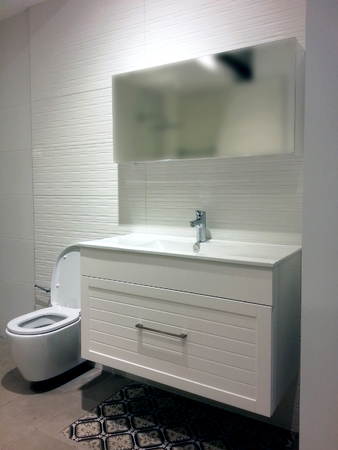 Modern bright bathroom design with a toilet.