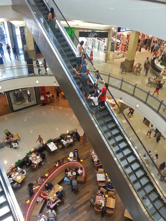 PETAH TIKWA, ISRAEL- September 08, 2017: People visiting shopping center in Big Mall (Canion Hagadol) complex in Petah TikwaPeople on escalator and walking in the shopping mall - sale, consumerism and people concept.