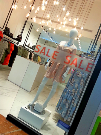 Mannequin behind glass with a sale sign on , store sale in a shopping mall in Tel Aviv,Israel