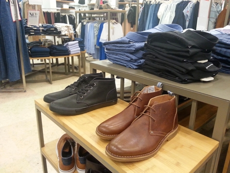 Storefront display of men`s  clothes and Shoes.New Collection