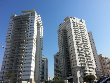 Modern, new executive apartments  buildings with deep blue summer sky