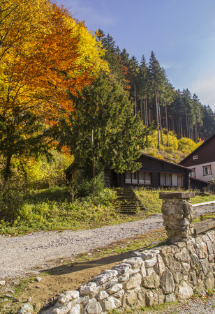 Carpathian mountains in the autumn with a wooden house. Colorful autumn landscape scene. Stock Photo