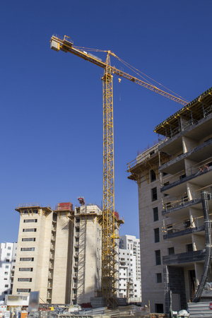 High-rise residential buildings under construction. The site with cranes