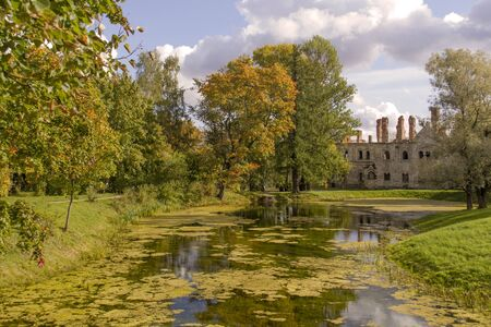 Autumn landscape of the Alexander Park and Ruins of Fedorovsky town in the Pushkin town