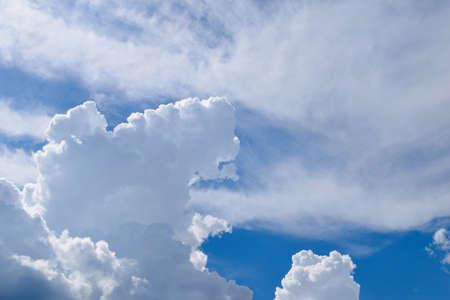 thunderhead: Fluffy white clouds against a blue sky Stock Photo