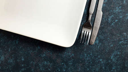 Cutlery knife and fork on textured table