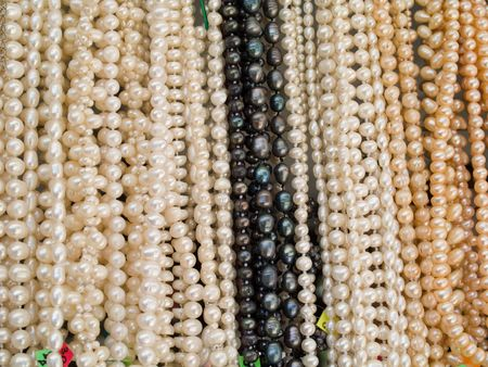 perls: Close-up of different colored bijouterie from perls that can be use as texture or background