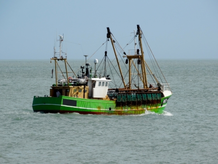 fishing industry: Fishing Trawler heading out to sea