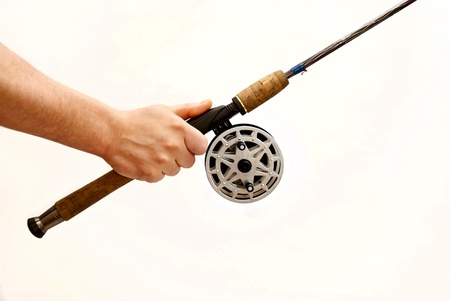 spinning reel: man holding a spinning reel on a white background