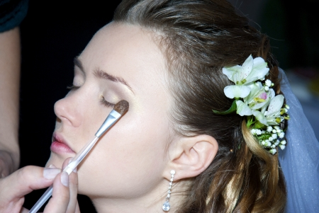 Pretty Bride getting make up on  photo