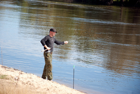 The manly art of fishing in the summer photo