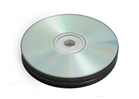 Stack of compact discs on white photo