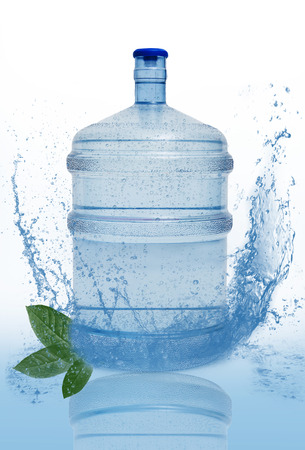 big bottle with clean blue water drink and green foliage  photo
