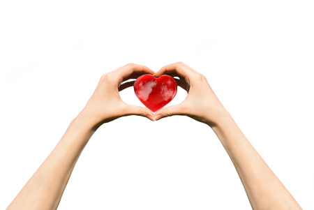 female teen hands holding heart photo