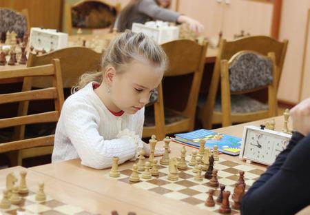 prodigy: Pretty Schoolgirl playing chess tournament