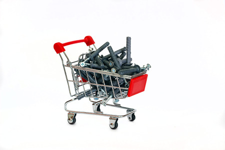 Dowels gray in the shopping cart on white photo