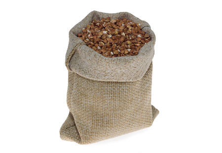 linen bag: buckwheat in linen bag on white background
