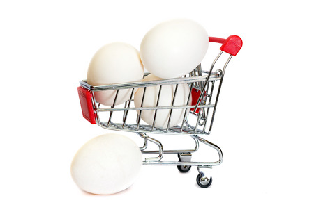 isolaten: Eggs in the shopping cart isolaten in white Stock Photo