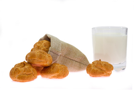 linen bag: Fragrant rolls in a linen bag isolated on white Stock Photo