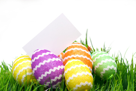 Easter eggs and blank note on white photo