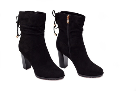 women's issues: Woman fashion heels ankle boot isolated
