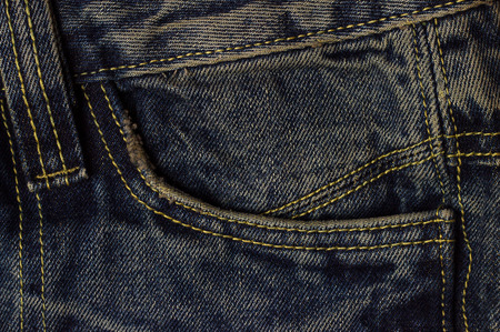 undone: background of dark blue jeans closeup