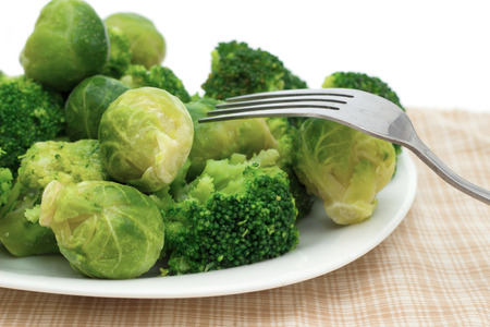 broccoli sprouts: broccoli and Brussels sprouts on a plate with a fork