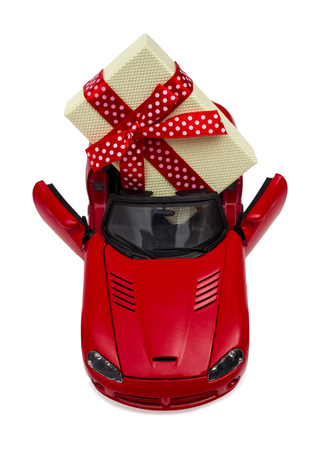 Car as a gift for a holiday on the white background Reklamní fotografie