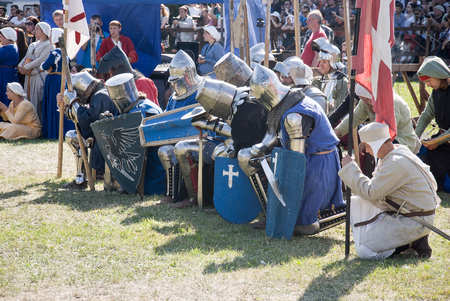 old man on a physical pressure: MINSK, BELARUS - JULY 25, 2015: Historical restoration of knightly fights of Battle of Grunwald