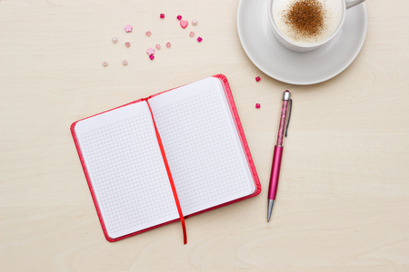 note pad: Red notebook with pen and coffee on wooden table