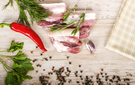 cow pea: Fresh meat : raw pork meat with red chili pepper, dill, garlic and rosemary on wooden board Stock Photo