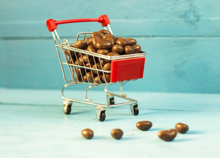dragee: Chocolate dragee on the blue wooden background