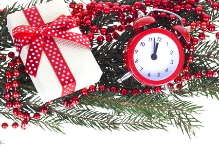 Christmas clock, bauble decor and snow fir tree. Isolated on white background