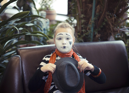 comedian: Pretty Girl in the form of mime actor Stock Photo